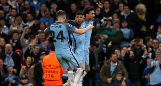 MANCHESTER, ENGLAND - FEBRUARY 21:  Sergio Aguero of Manchester City celebrates with John Stones and Leroy Sane after scoring his team's third goal to make the score 3-3 during the UEFA Champions League Round of 16 first leg match between Manchester City FC and AS Monaco at Etihad Stadium on February 21, 2017 in Manchester, United Kingdom.  (Photo by Matthew Ashton - AMA/Getty Images)