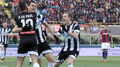 Udinese's Kevin Lasagna, second left, celebrates after scoring during the Italian serie A soccer match between Bologna and Udinese at  the Dall'Ara stadium in Bologna, Italy, Saturday, Dec. 30, 2017. (Giorgio Benvenuti/ANSA via AP)